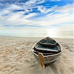 Boat on the beach at sunrise time Stock Photo - Royalty-Free, Artist: GoodOlga, Code: 400-04923696