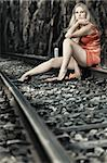 Young beautiful woman sitting on train track Stock Photo - Royalty-Free, Artist: GoodOlga                      , Code: 400-04923697