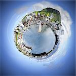 Living in your own world makes life simple and pleasant. A spherised manipulation of a panoramic stitch from 34 images of the arctic fishing village of Husavik, Iceland Stock Photo - Royalty-Free, Artist: corepics                      , Code: 400-04923803