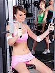 Portrait of young female exercising in gym... Stock Photo - Royalty-Free, Artist: get4net                       , Code: 400-04924514