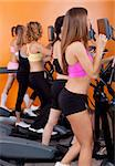 Group of women running on treadmill in gym or fitness club to gain more fitness.. Stock Photo - Royalty-Free, Artist: get4net, Code: 400-04924519