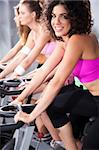 Gorgeous young females cycling in spinning class in gym. Stock Photo - Royalty-Free, Artist: get4net, Code: 400-04924565