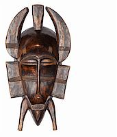 Traditional carved wooden African masks Stock Photo - Royalty-Freenull, Code: 400-04925694