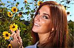 Beautiful Red Haired Woman Outdoors in a Sunflower Field Stock Photo - Royalty-Free, Artist: tobkatina                     , Code: 400-04925883