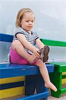 Little Girl Putting on Shoe Stock Photo - Premium Rights-Managednull, Code: 700-04926434