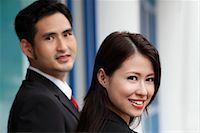 southeast asian - head shot of man and woman smiling Stock Photo - Premium Royalty-Freenull, Code: 656-04926601
