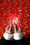 Cropped shot of hands holding red envelopes Stock Photo - Premium Royalty-Free, Artist: Jose Luis Stephens, Code: 656-04926611