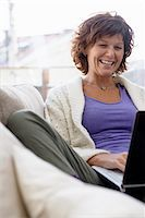 Woman using laptop Stock Photo - Premium Royalty-Freenull, Code: 6102-04929486