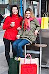 Pair of young women taking break from shopping, drinking takeaway coffee Stock Photo - Premium Royalty-Freenull, Code: 6102-04929549
