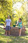 Couple Playing Horseshoes in Park Stock Photo - Premium Rights-Managed, Artist: Ty Milford, Code: 700-04931688