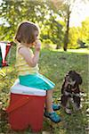 Girl Sitting on Cooler Eating Hamburger Stock Photo - Premium Rights-Managed, Artist: Ty Milford, Code: 700-04931691