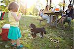 Little Girl and Dog at Picnic Stock Photo - Premium Rights-Managed, Artist: Ty Milford, Code: 700-04931692