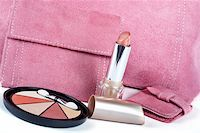 Detail of lipstick and Assortment of pink handbags on white background Stock Photo - Royalty-Freenull, Code: 400-04932587