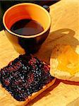 Close-up of a cup of coffee and two rusks with jam Stock Photo - Royalty-Free, Artist: citylights                    , Code: 400-04939636