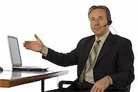 isolated businessman at the desk with headset Stock Photo - Royalty-Freenull, Code: 400-04941176