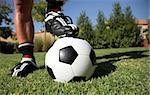 Man standing with his foot/ soccerboot on the soccer ball in his back yard. Stock Photo - Royalty-Free, Artist: jacojvr                       , Code: 400-04944694