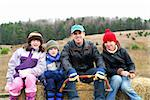 Family sitting on a vagon on Christmas tree farm Stock Photo - Royalty-Free, Artist: Elenathewise                  , Code: 400-04945436