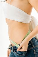 fat italian woman - close up of a girl measuring her self with a green meter Stock Photo - Royalty-Freenull, Code: 400-04945629