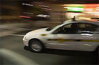 night shot of speeding taxi in sydney Stock Photo - Royalty-Freenull, Code: 400-04953495