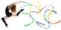 feet gymnast - a modern dancer with black dress jumping with colored strings Olympic color  Stock Photo - Royalty-Freenull, Code: 400-04961893