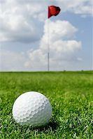 golf ball and flag -- short putt. Focus on ball Stock Photo - Royalty-Freenull, Code: 400-04974251