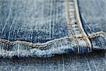 Jeans. The seam. The background.  The interesting invoice dark blue Jeans, macro  photo of a seam. Stock Photo - Royalty-Free, Artist: TAIGA                         , Code: 400-04977308