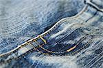 Jeans. The seam. The background.  The interesting invoice dark blue Jeans, macro  photo of a seam. Stock Photo - Royalty-Free, Artist: TAIGA                         , Code: 400-04977309