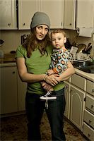 Mother Holding Son in Messy Kitchen Stock Photo - Premium Rights-Managednull, Code: 700-04981807