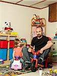 Father and Daughter in Playroom Stock Photo - Premium Rights-Managed, Artist: Shelley Smith, Code: 700-04981809