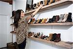 Shop Owner Arranging Shoes on Shelf Stock Photo - Premium Rights-Managed, Artist: Sarah Murray, Code: 700-04981813