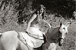 Attractive girl riding on horse in deserted rural location Stock Photo - Royalty-Free, Artist: mocker                        , Code: 400-04992205