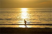 sweaty woman - runing woman at the sunrise, Patong beach, Phuket, Thailand Stock Photo - Royalty-Freenull, Code: 400-04992342