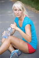 sweaty woman - cool water after the long run Stock Photo - Royalty-Freenull, Code: 400-04994373