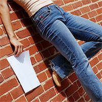 female crotch - Fashionable girl against red brick wall with blank paper. Stock Photo - Royalty-Freenull, Code: 400-04998335