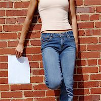 female crotch - Fashionable girl against red brick wall with blank paper. Stock Photo - Royalty-Freenull, Code: 400-04998336