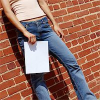 female crotch - Fashionable girl against red brick wall with blank paper. Stock Photo - Royalty-Freenull, Code: 400-04998337