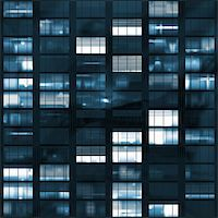 Voyeuring Office Building After Dark In Blue Tones Stock Photo - Royalty-Freenull, Code: 400-04999487