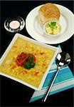 Roasted capsicum chili and corn chowder in a dark blue table setting. Stock Photo - Royalty-Free, Artist: jabiru                        , Code: 400-05007293