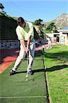 A golfer in action on a practice or driving range, hitting the ball with a club. Stock Photo - Royalty-Free, Artist: Vatikaki                      , Code: 400-05008203