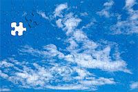 A blue sky background puzzle with displaced piece in blue Stock Photo - Royalty-Freenull, Code: 400-05012832