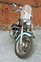 Old blue motorcycle at a brick wall Stock Photo - Royalty-Freenull, Code: 400-05017762