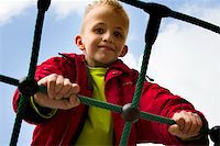 A young boy playing at the playground. Stock Photo - Royalty-Freenull, Code: 400-05018739