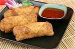 Crispy Chinese egg rolls with sweet, tangy chili sauce for dipping. Stock Photo - Royalty-Free, Artist: lisafx                        , Code: 400-05021100