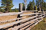 A series of wood rails is part of the fence surrounding a corral on a ranch in Central Oregon. Stock Photo - Royalty-Free, Artist: searagen                      , Code: 400-05028395