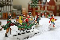Kids on a sleigh ride caroling Stock Photo - Royalty-Freenull, Code: 400-05029914