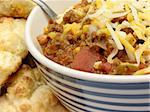 Chili with cheese and a spoon with biscuits on the side Stock Photo - Royalty-Free, Artist: elvinstar                     , Code: 400-05031258