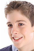 happy young boy profile shot Stock Photo - Royalty-Freenull, Code: 400-05042920