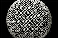 abstract close-up of a studio microphone on black Stock Photo - Royalty-Freenull, Code: 400-05057225
