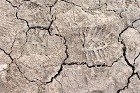 Close up of cracked dried soil with footprint Stock Photo - Royalty-Freenull, Code: 400-05059377