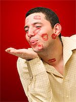 man portrait with many kisses on his face Stock Photo - Royalty-Freenull, Code: 400-05062575